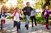 istock School kids running in schoolyard 895483458