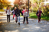 istock School kids running in schoolyard 895483576