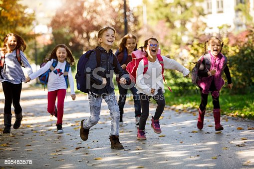 istock School kids running in schoolyard 895483578