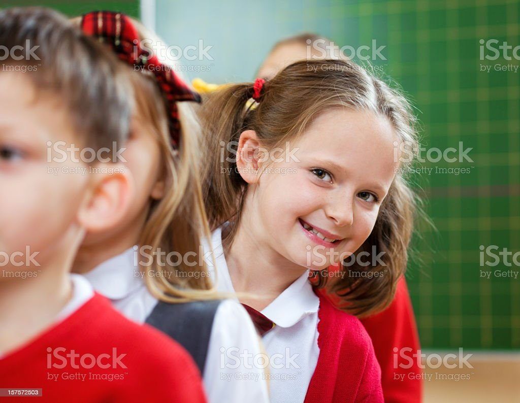 School Kids Standing In A Row, Girl Peeking Out royalty-free stock photo