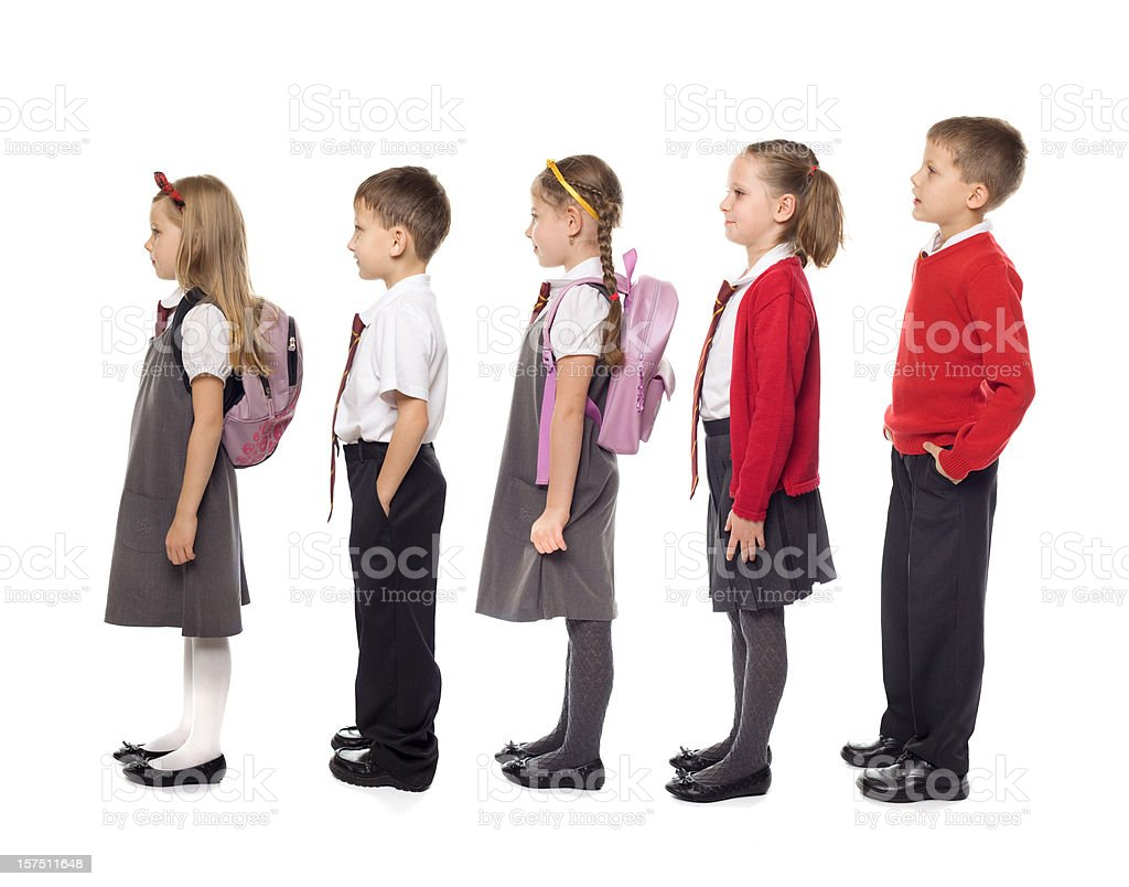 School Kids Standing In Line, Studio Isolated stock photo