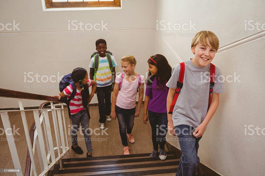 School kids walking up stairs in school stock photo