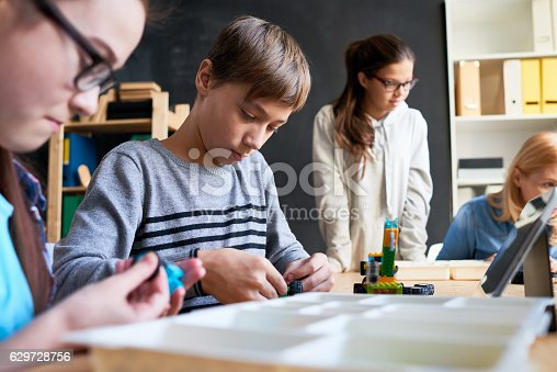 865870702 istock photo School kids working on toy project 629728756