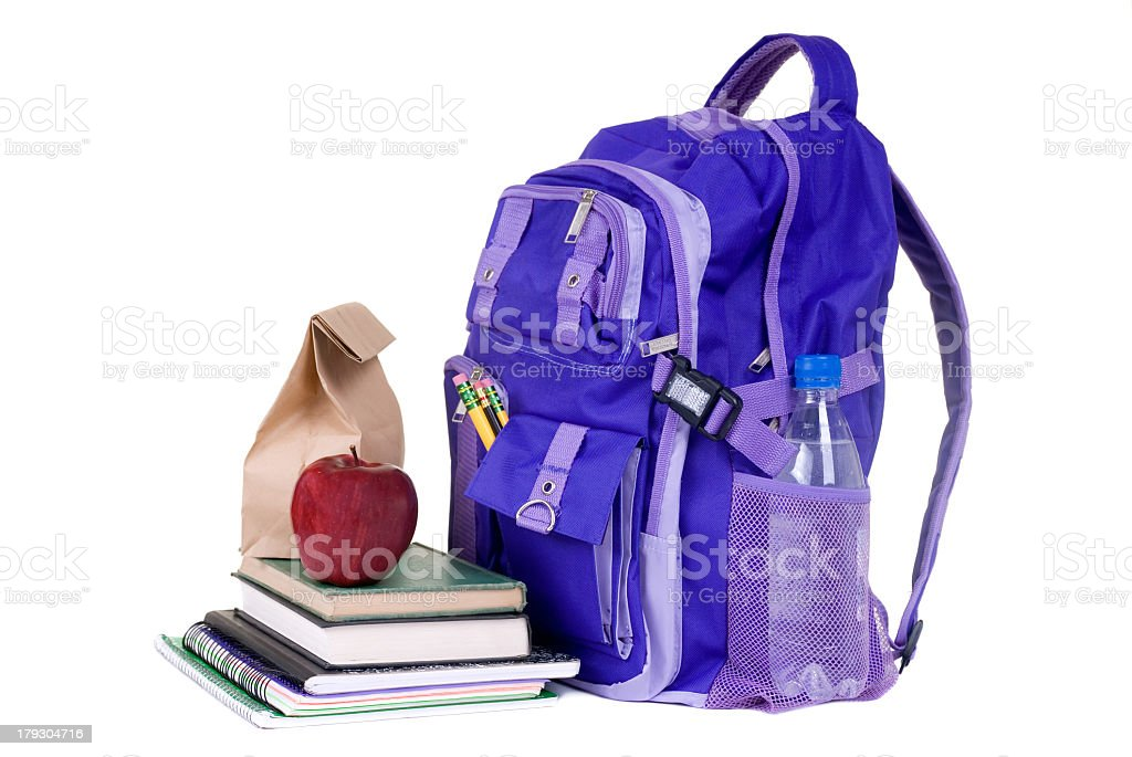 School kit with backpack, books and snacks royalty-free stock photo
