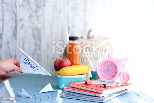 istock School lunch box for kids. Back to school. Cooking. Child's hands. Top view. 962756144