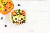 School lunch box for kids on white wooden background. Back to school. Top view, flat lay, copy space