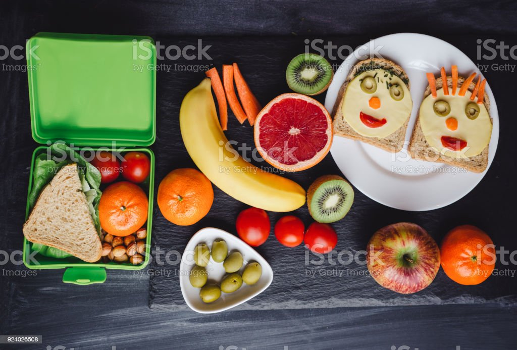 School lunch boxes with sandwich and fresh vegetables stock photo