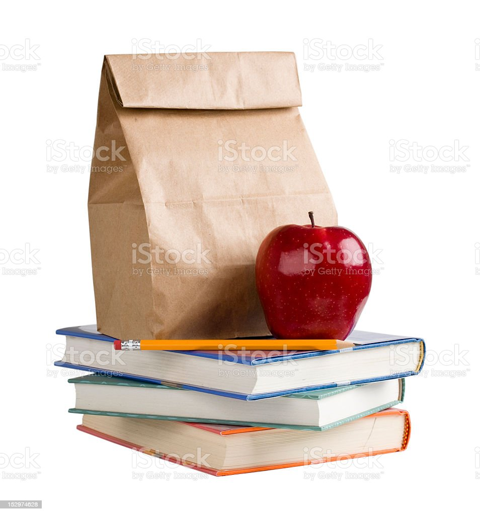 School lunch on top of a pile of books stock photo