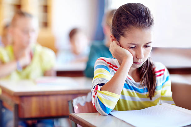 School makes her bored stock photo