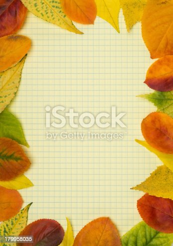 istock School notebook and frame of autumn leaves 179958035