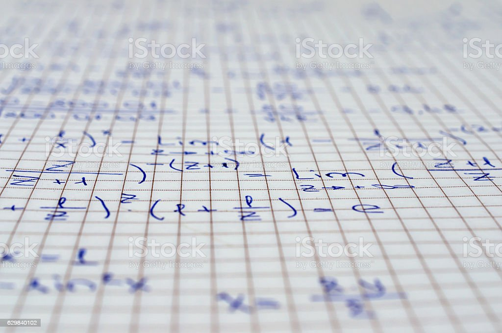 School Notebook With Handwritten Algebra Equations stock photo