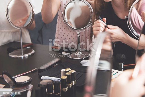 istock School of makeup. Makeup master class for teenage girls. 1094891420