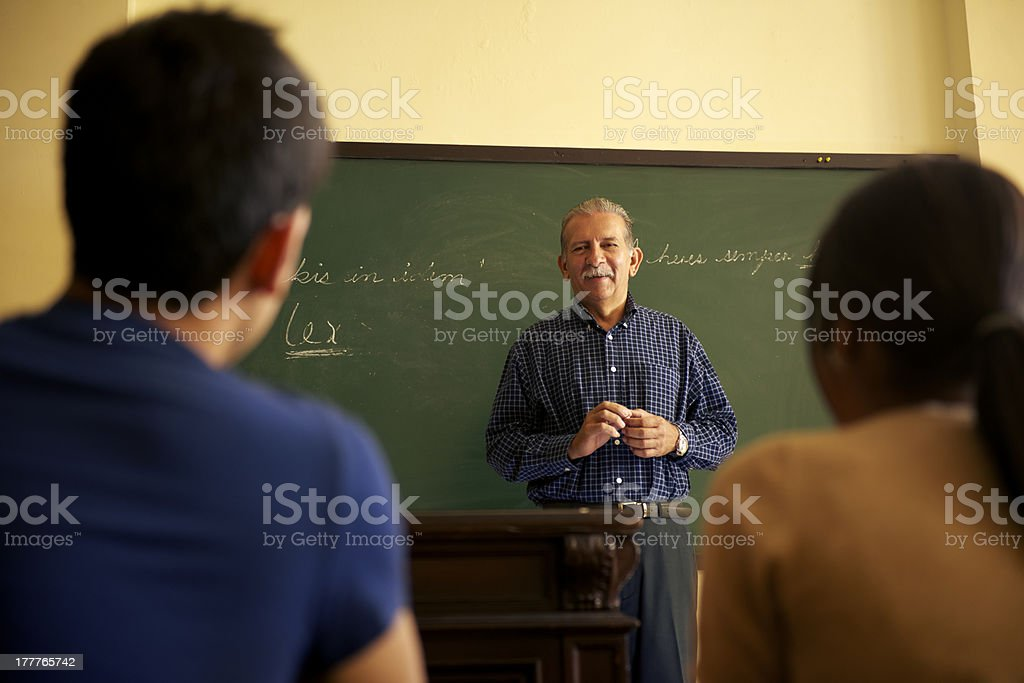 School people, professor talking to students during lesson in co royalty-free stock photo