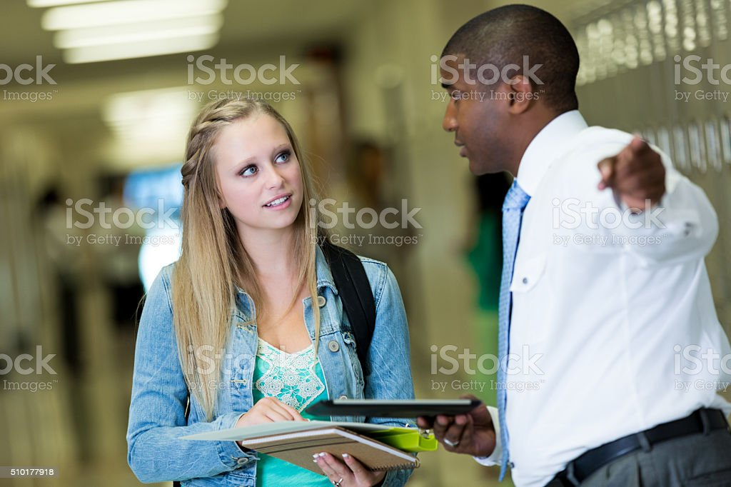 School principal helps student find class stock photo