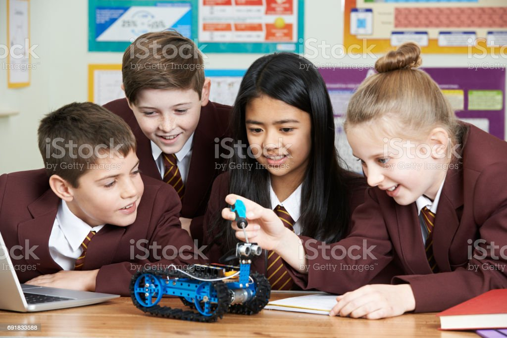 School Pupils In Science Lesson Studying Robotics royalty-free stock photo