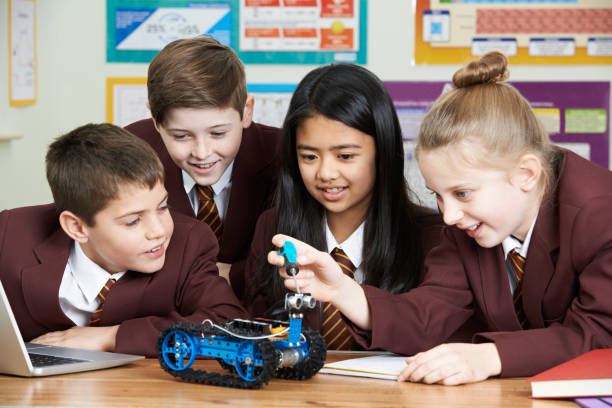 School Pupils In Science Lesson Studying Robotics stock photo