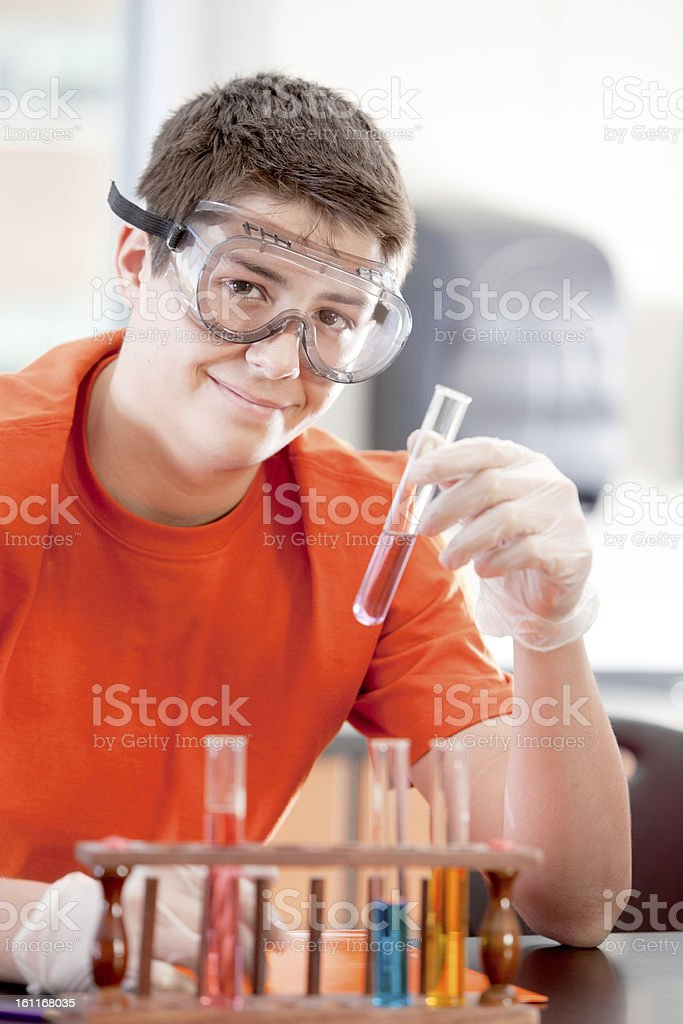 School Science: Hispanic Teenage Student Learning Chemistry Class royalty-free stock photo