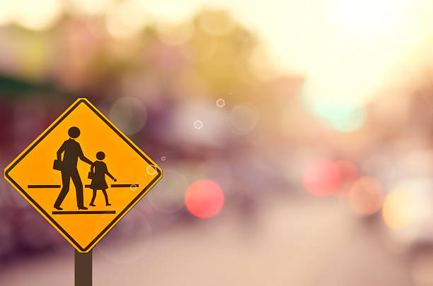 School sign on blur traffic road abstract background. stock photo