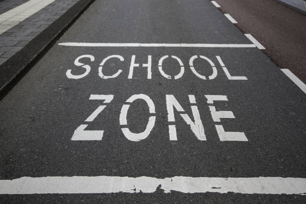 School signal on the asphalt School sign on the asphalt, information traffic sign time zone stock pictures, royalty-free photos & images
