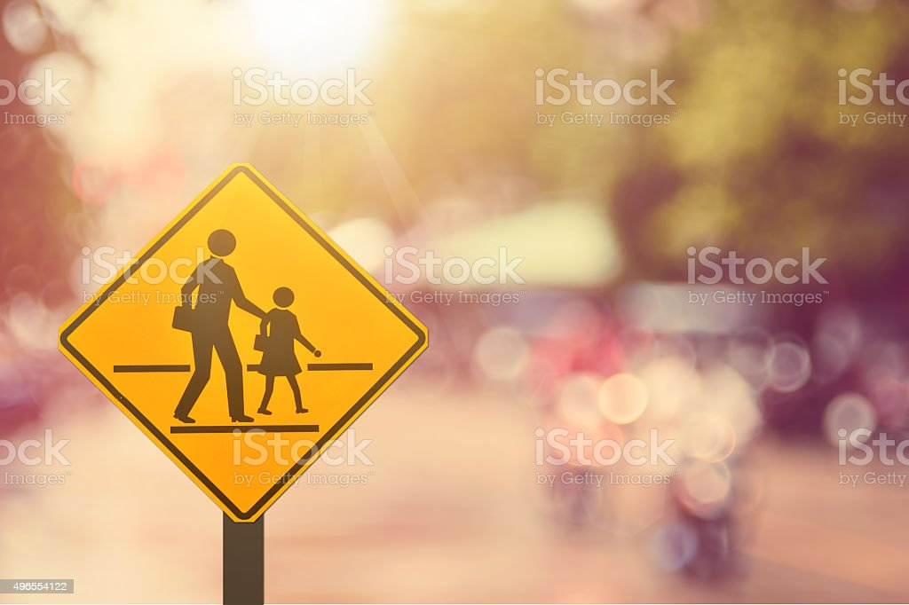 School sign.Traffic sign road on blur road abstract background. stock photo