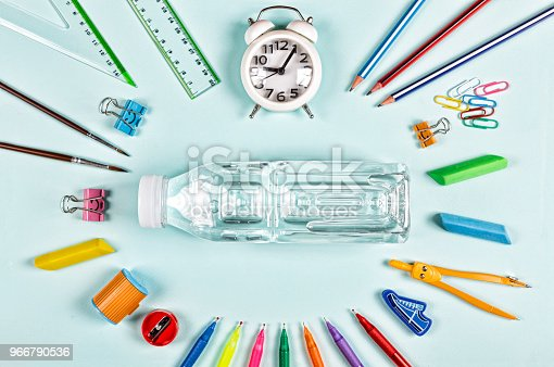 istock school snack. bottle of water, school supplies. Back to school concept. Flat lay stylish set top view. copy space. 966790536