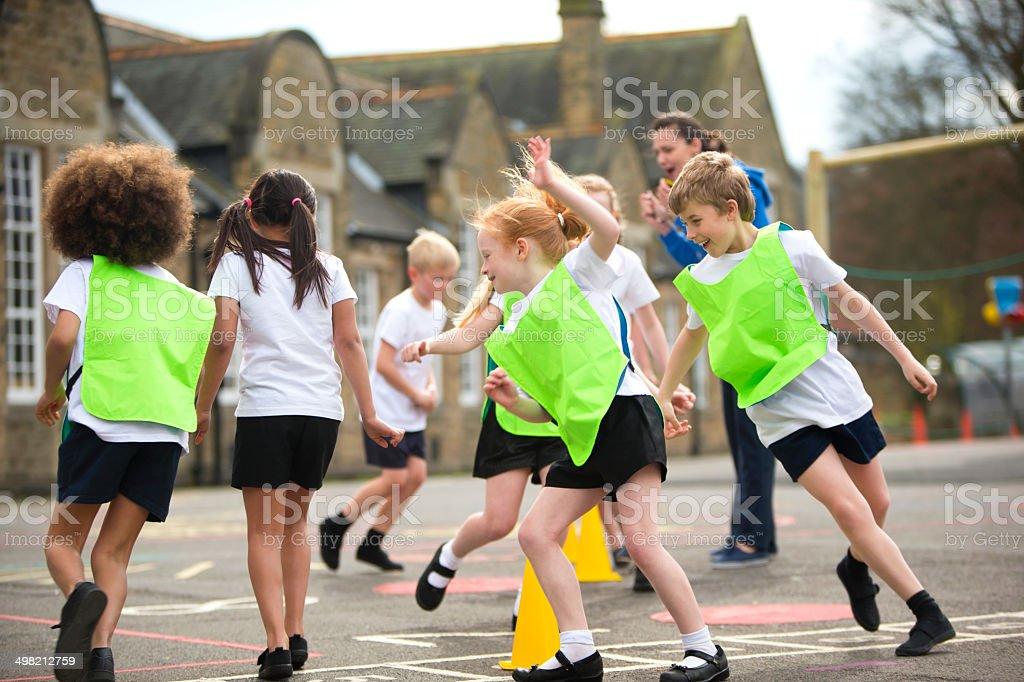 Children running around in the school playground during a physical...