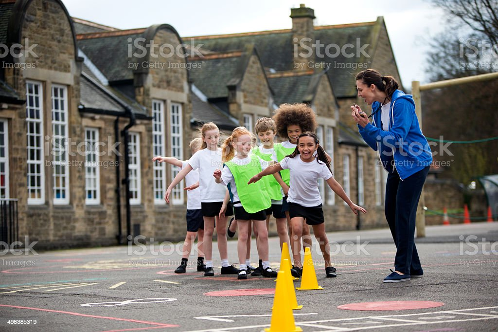 Children in the school playground during a physical education lesson