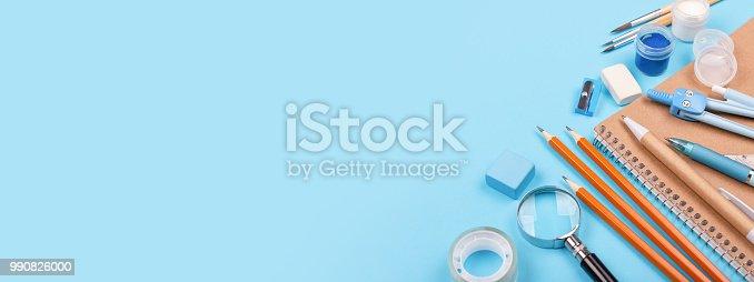istock School stationary on blue background. 990826000