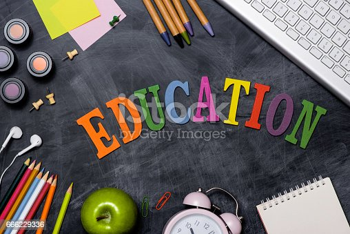 istock School stationery or office supplies on chalkboard background. 666229336