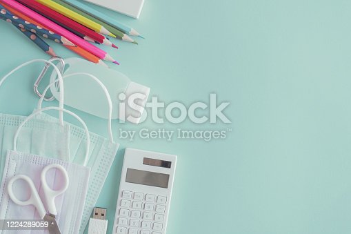 istock School stationery supplies, medical masks and hand gel sanitizer, school reopening, returning back to school after covid-19 coronavirus pandemic is over, new normal concept 1224289059