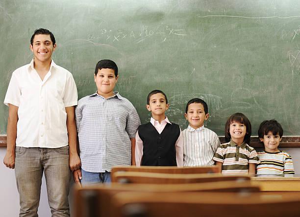 School student generations steps, from preschooler to university stock photo