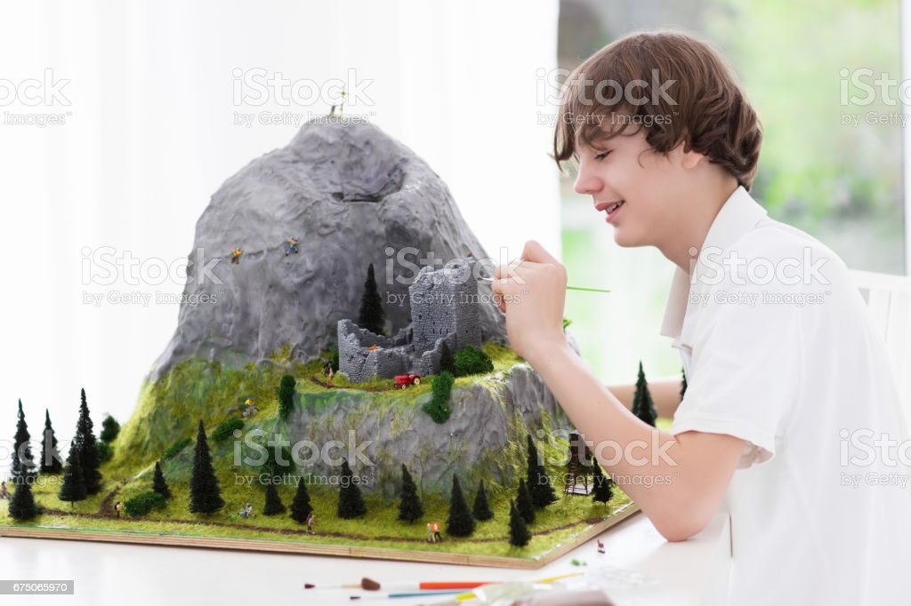 School student working on model building project stock photo