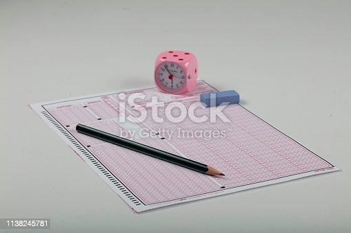 806639724 istock photo School Students hands taking exams, writing examination holding pencil on optical form of standardized test with answers sheet doing final exam in classroom. Education assessment Concept. Soft focus 1138245781