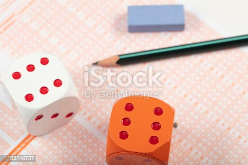 806639724 istock photo School Students hands taking exams, writing examination holding pencil on optical form of standardized test with answers sheet doing final exam in classroom. Education assessment Concept. Soft focus 1138246737