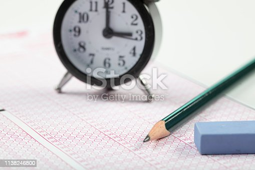 806639724 istock photo School Students hands taking exams, writing examination holding pencil on optical form of standardized test with answers sheet doing final exam in classroom. Education assessment Concept. Soft focus 1138246800