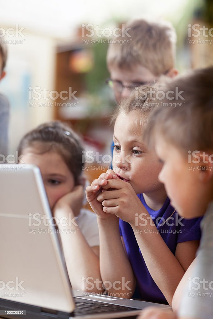 School students look at Laptop stock photo