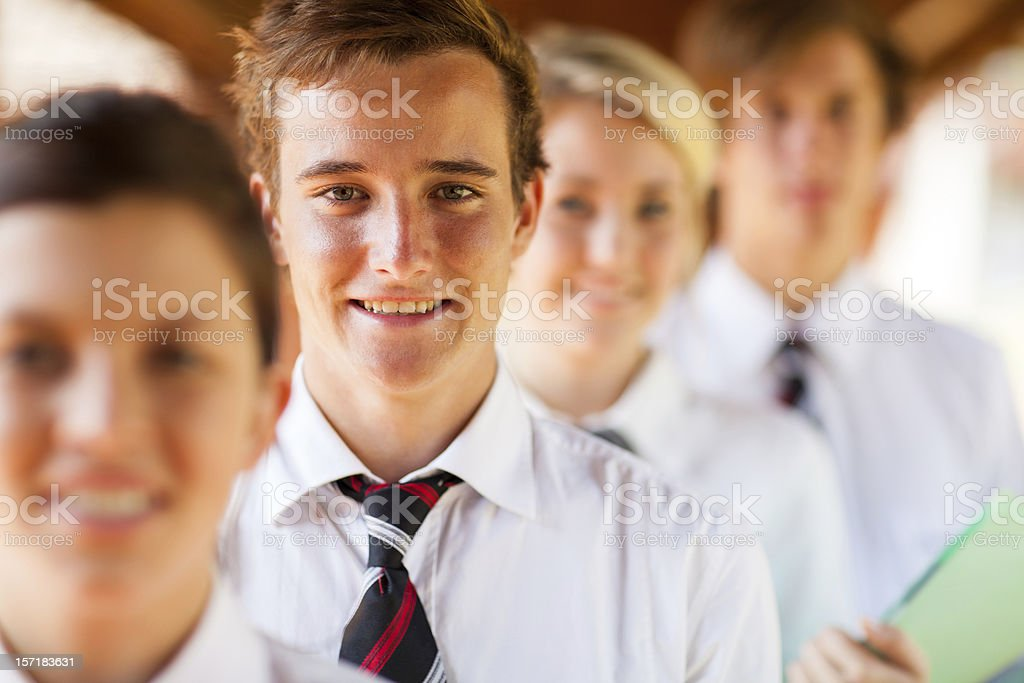 School students standing in a single file stock photo