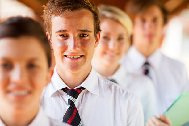 School students standing in a single file high school students group portrait cute middle school girls stock pictures, royalty-free photos & images