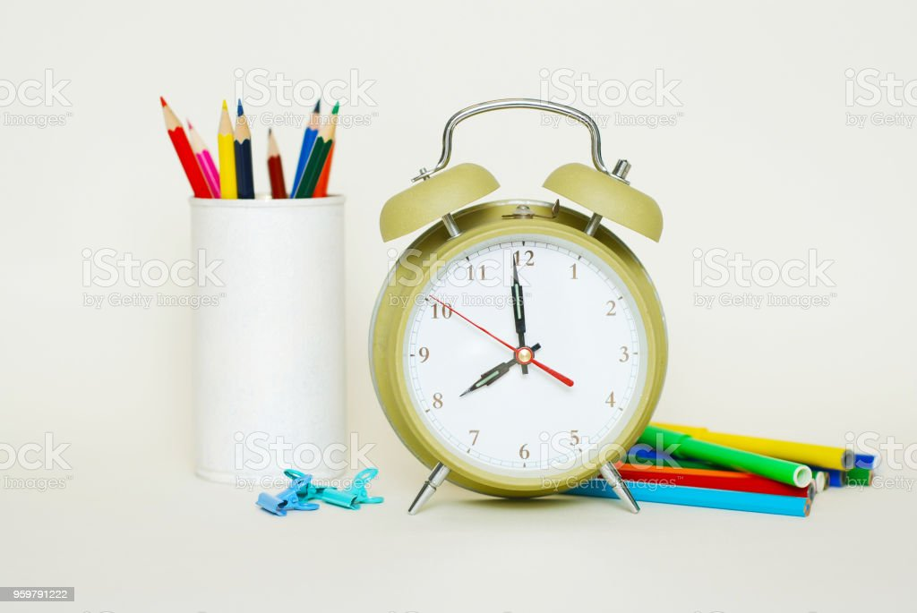 School suplies. colored Crayons. Green Clock Isoalted on White Background stock photo