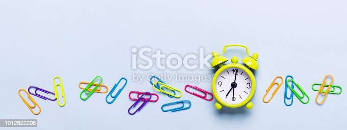 istock School supplies and alarm clock on a blue background 1012622208