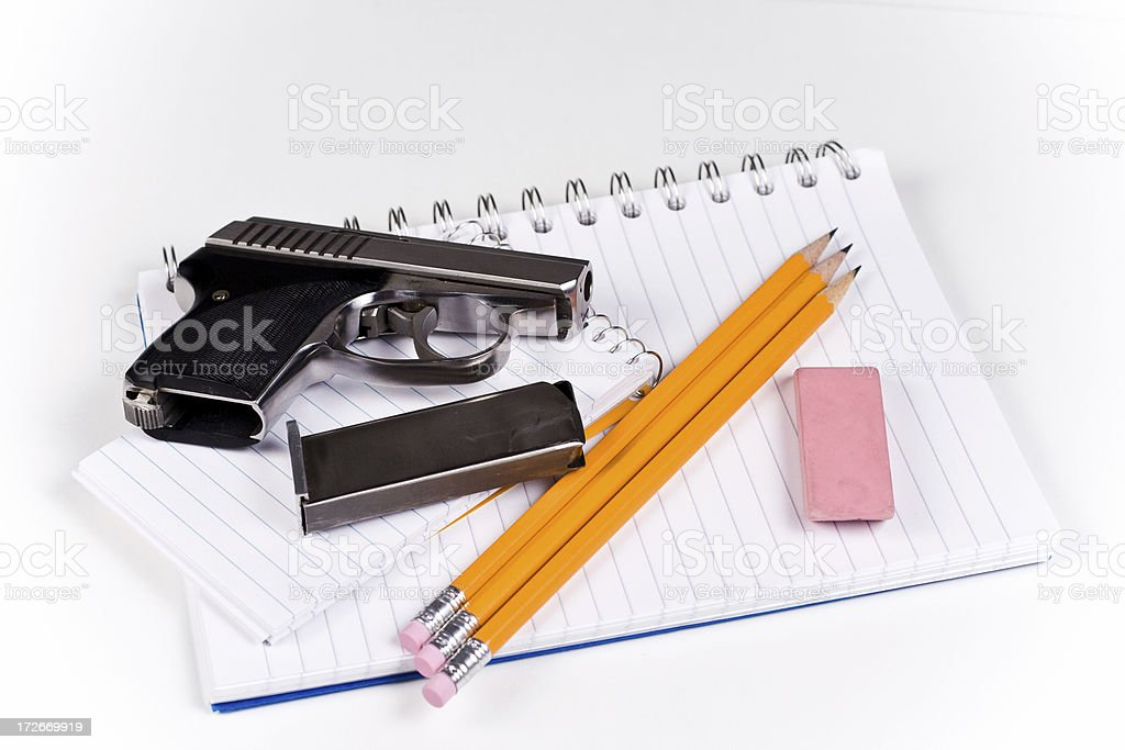 School supplies and pistol royalty-free stock photo