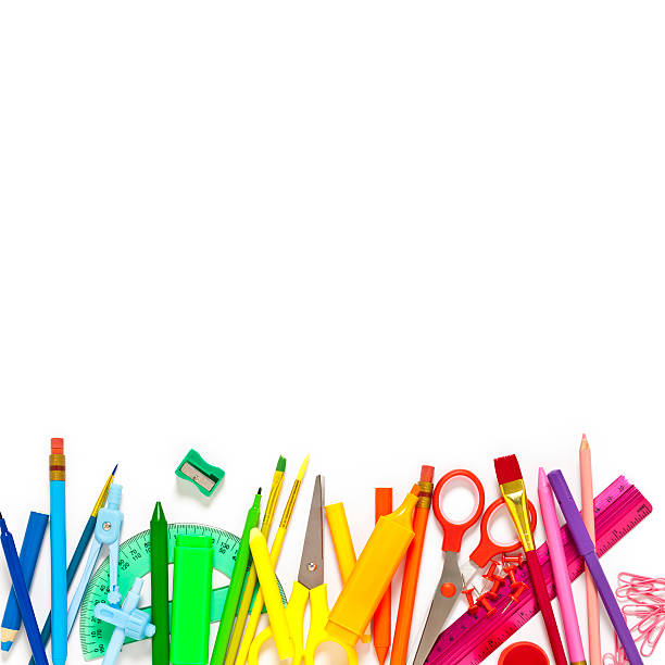 School supplies border against white background Large group of rainbow colored school supplies coming from the top and bottom of the frame shot from above against white background leaving a useful copy space at the center. The composition includes crayons, paper clips, color pencil, paintbrushes, watercolors, pencil sharpener, scissors, compass, ruler, and pushpins. DSRL studio photo taken with Canon EOS 5D Mk II and Canon EF 100mm f/2.8L Macro IS USM school supplies border stock pictures, royalty-free photos & images