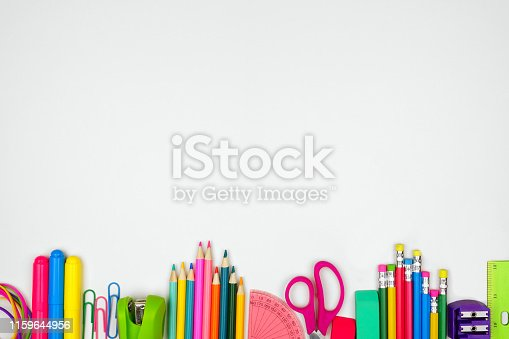 School supplies bottom border. Top view on a white background with copy space. Back to school concept.
