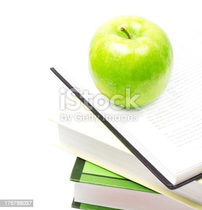 453684295istockphoto School supplies composition  in classroom with books and apple 175788037