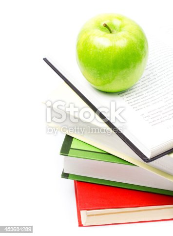 453684295istockphoto School supplies composition  in classroom with books and apple 453684289