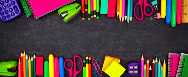 School supplies double border banner, top view on a chalkboard background with copy space. Back to school. stock photo