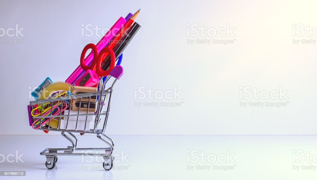 school supplies in shopping cart - back to school stock photo