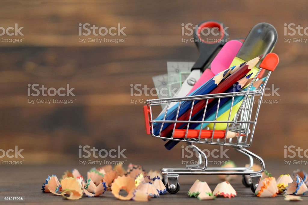 School supplies in shopping cart stock photo