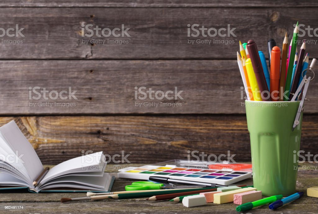 school supplies on a wooden background - Royalty-free Art Stock Photo