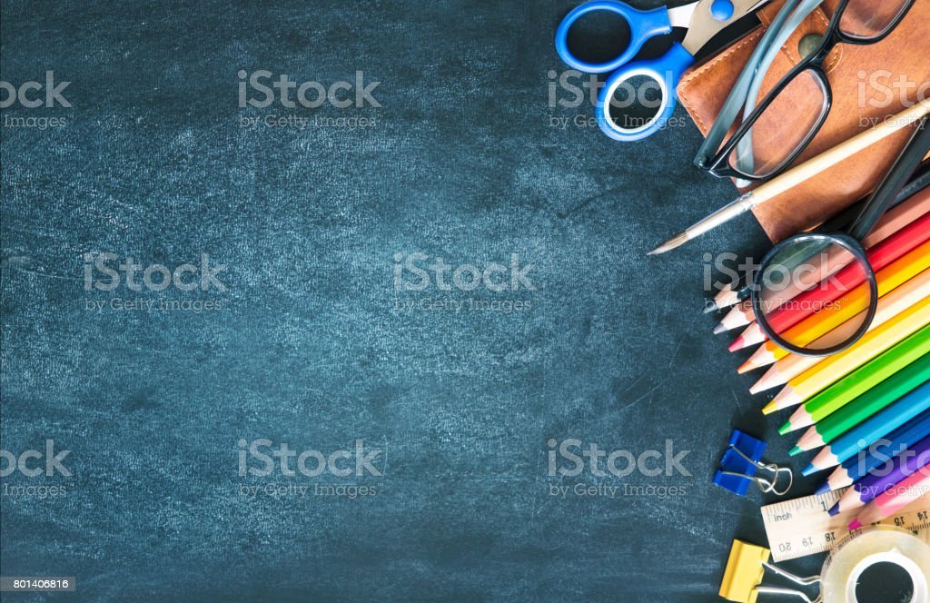 School supplies on black board background empty copy space. stock photo